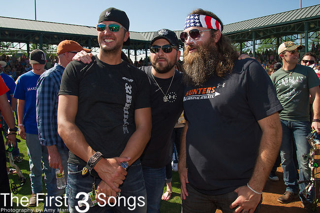 Recording artist Luke Bryan, recording artist Tyler Farr, and TV personality Willie Robertson attend the ACM & Cabela's Great Outdoor Archery Event during the 50th Academy Of Country Music Awards at the Texas Rangers Youth Ballpark on April 18, 2015 in Arlington, Texas.
