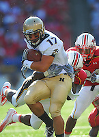 Mike Stukel of the Navy is brought down by the Terrapins' defense. Maryland defeated Navy 17-14 at the M&T Bank in Baltimore, MD on Monday, September 6, 2010. Alan P. Santos/DC Sports Box