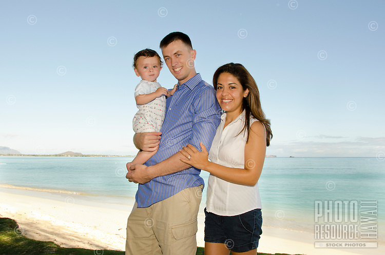 Military family with mom, dad and infant on Kailua beach, Windward Oahu.