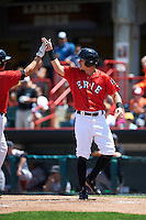 Erie Seawolves Jason Krizan high fives Corey Jones (left) after a home run during a game against the Altoona Curve on July 10, 2016 at Jerry Uht Park in Erie, Pennsylvania.  Altoona defeated Erie 7-3.  (Mike Janes/Four Seam Images)