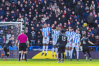 Crystal Palace's midfielder Luka Milivojevic (4) curls his free kick wide during the EPL - Premier League match between Huddersfield Town and Crystal Palace at the John Smith's Stadium, Huddersfield, England on 17 March 2018. Photo by Stephen Buckley / PRiME Media Images.