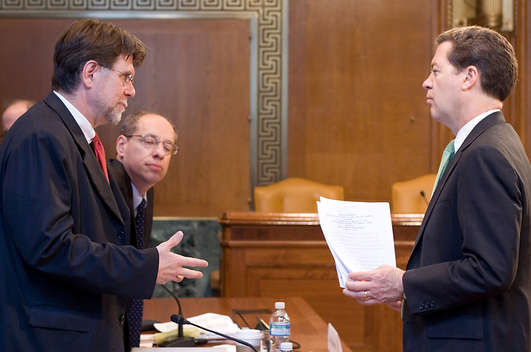 WASHINGTON, DC - May 14, 2008: William E. Kovacic (right), chairman of the Federal Trade Commission, and Jon Leibowitz, an FTC commissioner, speak to Senator Sam Brownback (R-Kan.) prior to Senate Appropriations hearing on funding for the FTC. (Photo by Ryan Kelly/Congressional Quarterly)