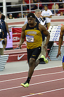 Missouri freshman Markesh Woodson sprints to a 5th place finish in his 60 Meter Dash preliminary heat at the 2013 NCAA Division I Indoor Track and Field Championships in Fayetteville, Ar. Woodson finished in 6.65 seconds to earn the eigth and final spot in Saturdays final.