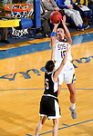 BROOKINGS, SD - JANUARY 7:  Kerri Young #10 from South Dakota State spots up for a jumper over Amber Vidal #5 from the University of Nebraska Omaha during their game Saturday afternoon at Frost Arena in Brookings. (Dave Eggen/Inertia)