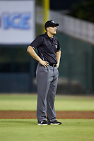 Umpire Justin Whiddon handles the calls on the bases during the South Atlantic League game between the Lakewood BlueClaws and the Kannapolis Intimidators at Kannapolis Intimidators Stadium on July 7, 2018 in Kannapolis, North Carolina. The Intimidators defeated the BlueClaws 4-3 in 10 innings.  (Brian Westerholt/Four Seam Images)