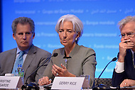 Washington, DC - April 16, 2015: Christine Lagarde, Managing Director of the International Monetary Fund, holds a press availability April 16, 2015 at the International Monetary Fund Headquarters in the District of Columbia during the annual Spring Meeting of the World Bank Group/IMF. At left, David Lipton, First Deputy Managing Director, IMF. At right, Gerry Rice, IMF Director of Communications.  (Photo by Don Baxter/Media Images International)