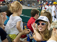 Katie Lewis of Washington, DC plays with fourteen month old Ellie Brooker of Fairfax, Virginia during the 56th Annual Congressional Baseball Game for Charity where the Democrats play the Republicans in a friendly game of baseball at Nationals Park in Washington, DC on Thursday, June 15, 2017. Photo Credit: Ron Sachs/CNP/AdMedia