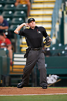 Home plate umpire Derek Thomas ejects Jorge Mateo (not shown) for drawing a line in the dirt during the second game of a doubleheader between the Tampa Yankees and Bradenton Marauders on June 14, 2017 at LECOM Park in Bradenton, Florida.  Tampa defeated Bradenton 5-1.  (Mike Janes/Four Seam Images)