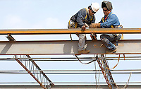 02/22/07:  Construction workers attach secure steel beams during expansion/construction of a Charlotte-area shopping center. Charlotte, NC, is one of the country's fastest-growing cities. ..By Patrick Schneider- Patrick Schneider Photography.