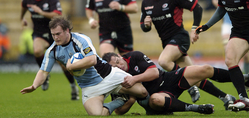Photo: Jonathan Butler..Saracens v Glasgow Rugby. European Challenge Cup. 22/10/2006..Kevin Yates of Saracens tackles Fergus Thomson of Glasgow.