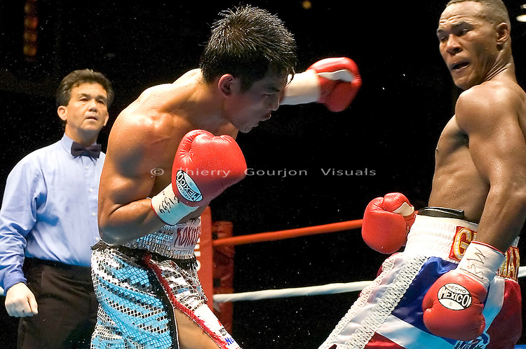 Terdsak Jandaeng (l)on the attack against Joan Guzman during their WBO Featherweight Eliminator Fight at the Westchester County Center, White Plains, NY on 08.26.2005..Guzman won by unanimous decision.