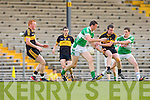 Padraig Lucey Legion competes for the loose ball with Shane Doolan and Johnny Buckley Dr Crokes during their County Championship clash in Fitzgerald Stadium on Saturday