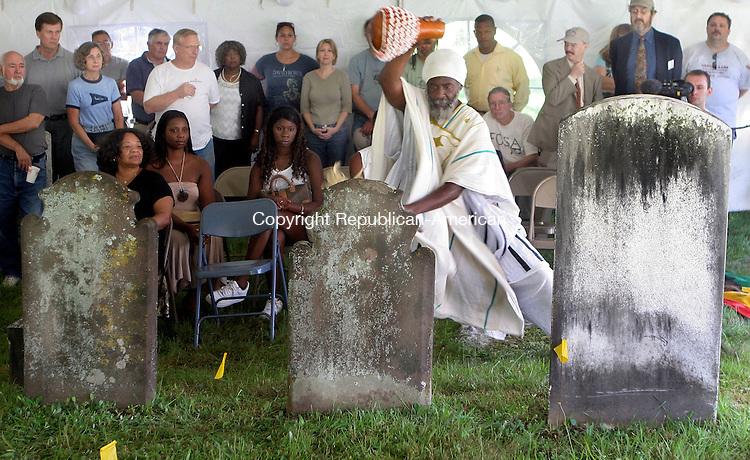 EAST HADDAM, CT-24July 2006-072406TK02- Abishai Ben Reuben Bey of Sounds of Africa peorlmed a Libation Ceremony over the grave of 18th centurey slave Venture Smith. Tom Kabelka Republican-American (Abishai Ben Reuben Bey)