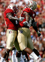 TALLAHASSEE, FL 9/18/10-FSU-BYU FB10 CH-Florida State'sv Markus White, right, celebrates sacking Brigham Young quarterback Jake Heaps with Nigel Bradham during first half action Saturday at Doak Campbell Stadium in Tallahassee. .COLIN HACKLEY PHOTO