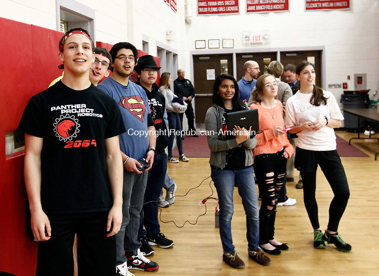"""Southbury, CT- 04 April 2014-040414CM08-  Members of the Pomperaug Robotics Team, watch as their robot  """"VIC"""" which in Latin stands for (Vectis Ignis Catapultam) put on a demonstration at the high school on Friday.  The team was on hand showing off the robot, which could qualify for the New England robotics competition, held in Boston, MA next week.     Christopher Massa Republican-American"""