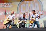Stephen Barker Liles, Jason Jordan, and Eric Gunderson of Love and Theft  perform on the Chevrolet Riverfront Stage during Day 1 of the 2013 CMA Music Festival in Nashville, Tennessee.
