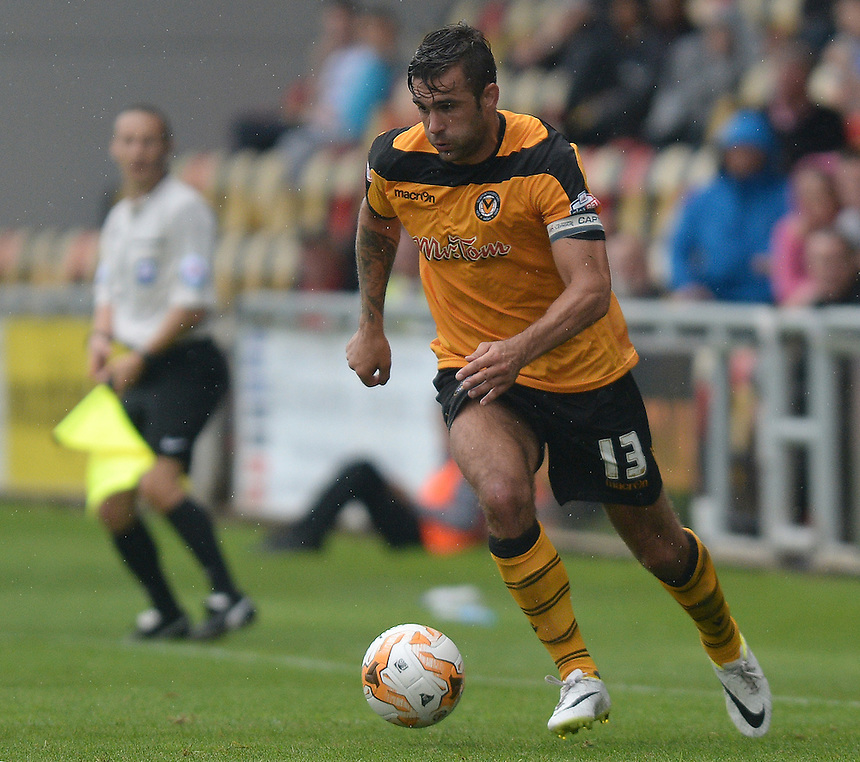 Newport County's Andy Sandell in action during todays match  <br /> <br /> Photographer Ian Cook/CameraSport<br /> <br /> Football - Newport County v Wycombe Wanderers - Sky Bet League 2 - Saturday 09th August 2014 - Rodney Parade - Newport<br /> <br /> &copy; CameraSport - 43 Linden Ave. Countesthorpe. Leicester. England. LE8 5PG - Tel: +44 (0) 116 277 4147 - admin@camerasport.com - www.camerasport.com