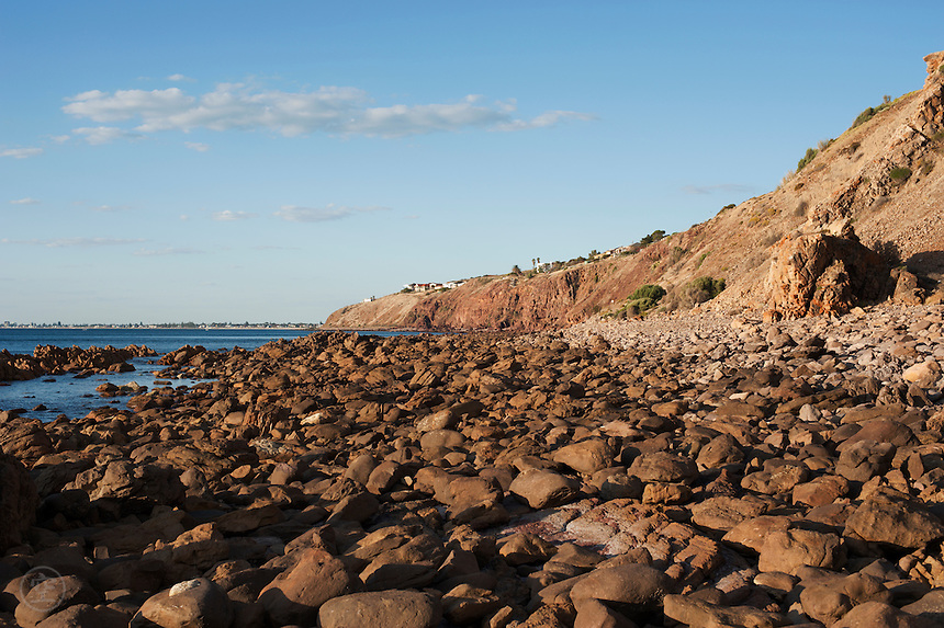 The rocky shore is warm in the evening light, Marino Rocks, South Australia.