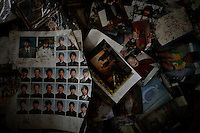 Photographs found in ruins are left at a shelter for those evacuated from the disaster zone in Rikuzentakata after the area was devastated by a magnitude 9.0 earthquake and tsunami March 29, 2011.   REUTERS/Damir Sagolj (JAPAN)