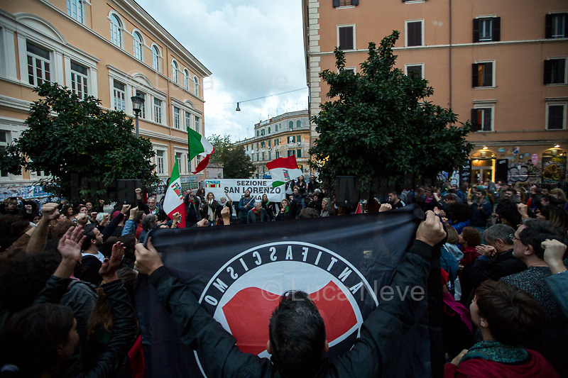 """Tina Costa (Antifascist Partizan. Member of the Partigiani: the Italian Resistance during WWII).<br /> <br /> Roma, 27/10/2018. Today Members of the far-right/neo-fascist political party 'Forza Nuova' (New Force), held a demonstration at Porta Maggiore in Rome in response to the rape and murder of the 16-year-old Desiree Mariottini committed in San Lorenzo district Friday the 19th October. <br /> In the meantime, ANPI (National Association of Italian Partizans), supported by other anti-fascist / anti-racist organizations, social centres, trade unions, and political parties, held a counter-demonstration in the heart of San Lorenzo, Piazza dell'Immacolata. The demo was called to protest against the rally of Forza Nuova (New Force), accused to be a fascist group trying to exploit the death of Desiree Mariottini, to propose """"fascist patrols"""" ('ronde' in Italian) in the famous WWII-anti-fascist neighbourhood of San Lorenzo, and for """"narrow-minded slander"""" ('sciacallaggio' in Italian).  <br /> The heavy police presence, in full riot gears, kept the two sides apart. A small group of provocateurs, armed of two 'Forza Nuova' (New Force) flags, were blocked by anti-fascists and police while they were trying to reach the area where Desiree Mariottini was killed in Via dei Lucani 22.  <br /> The sixteen-year-old Desiree Mariottini was found dead in a derelict-abandoned building (known for drug trafficking) in San Lorenzo district on October 19. The Italian police, in connection with the murder, arrested four people, two Senegalese, one Nigerian and one Ghanaian nationals, who allegedly drugged and gang raped Desiree while unconscious, before she died of an alleged overdose (For more info BBC website, https://bbc.in/2O5Sf8l)."""