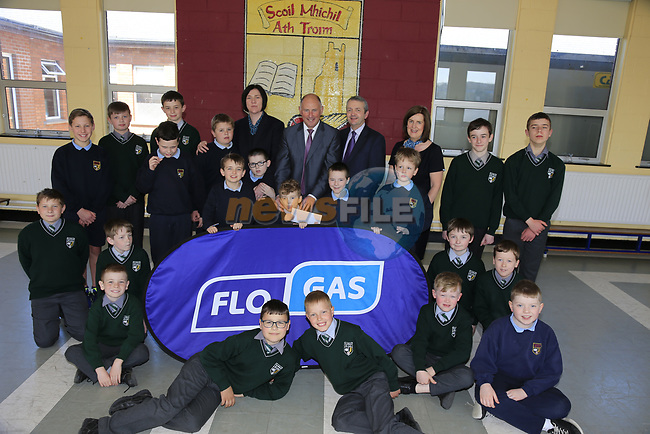 Flo Gas Marketing Manager Eoin O'Flynn and staff members Caroline Leddy and Liz Califf present a cheque from the proceeds of a sponsored walk in aid of St Michaels centre of Autism in Trim Co Meath to principle Fergal Fitzpatrick and students.<br /> Picture Newsfile | Fran Caffrey