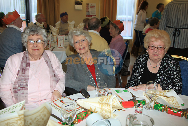 Therese O'Driscoll, Cathleen Meade and Mazie Smith.having there christmas dinner int he Dermot Kierans Centre..Picture Fran Caffrey/www.newsfile.ie.