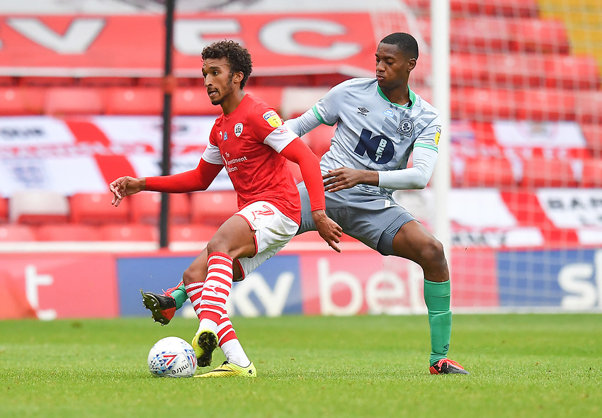 Blackburn Rovers' Tosin Adarabioyo battles with Barnsley's Jacob Brown<br /> <br /> Photographer Dave Howarth/CameraSport<br /> <br /> The EFL Sky Bet Championship - Barnsley v Blackburn Rovers - Tuesday 30th June 2020 - Oakwell - Barnsley<br /> <br /> World Copyright © 2020 CameraSport. All rights reserved. 43 Linden Ave. Countesthorpe. Leicester. England. LE8 5PG - Tel: +44 (0) 116 277 4147 - admin@camerasport.com - www.camerasport.com