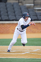 Anthony Gingerelli (7) of the Bucknell Bison hustles down the first base line against the Georgetown Hoyas at Wake Forest Baseball Park on February 14, 2015 in Winston-Salem, North Carolina.  The Hoyas defeated the Bison 8-5.  (Brian Westerholt/Four Seam Images)