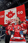 Todd Nicholson's wife and children cheer on their father during Sledge Hockey action at UBC Thunderbird Arena in Vancouver.