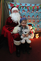 Pictured: Father Christmas meets young boy in his grotto. Thursday 15 December 2011<br />