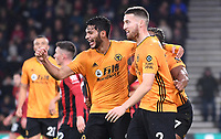 23rd November 2019; Vitality Stadium, Bournemouth, Dorset, England; English Premier League Football, Bournemouth Athletic versus Wolverhampton Wanderers; Raul Jimenez celebrates with Adama Traore and Matt Doherty of Wolverhampton Wanderers in scoring in 31st minute 0-2 - Strictly Editorial Use Only. No use with unauthorized audio, video, data, fixture lists, club/league logos or 'live' services. Online in-match use limited to 120 images, no video emulation. No use in betting, games or single club/league/player publications