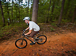 Mountain Biker races by on the trail at the US National Whitewater Center in Charlotte NC. Charlotte has many great attractions, and the Whitewater Center is one of the best.