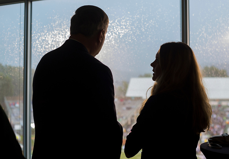 President Duane Nellis talks with Janetta King, the Founder of Innovation Ohio, in the Presidents box at Peden Stadium before the start of the Ohio Bobcats' football game against the Hampton Pirates on Sept. 2, 2017.