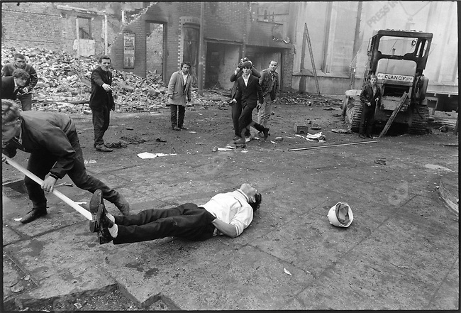 Catholic protester is shot during riots with the Ulster police, Londonderry, Northern Ireland, August 1969