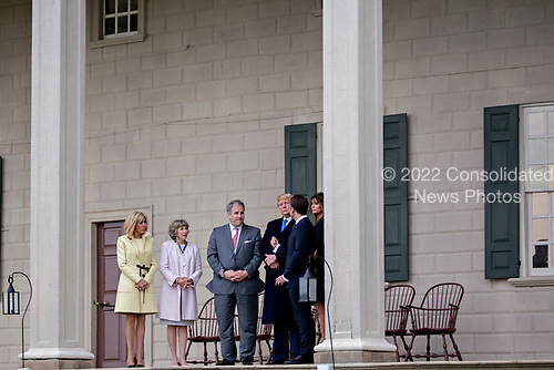 U.S. First Lady Melania Trump, from right, Emmanuel Macron, France's president, U.S. President Donald Trump, Doug Bradburn, president and chief executive officer of George Washington's Mount Vernon, Sarah Miller Coulson, Mount Vernon Ladies Association, and Brigitte Macron, France's first lady, tour outside the Mansion at the Mount Vernon estate of first U.S. President George Washington in Mount Vernon, Virginia, U.S., on Monday, April 23, 2018. As Macron arrives for the first state visit of Trump's presidency, the U.S. leader is threatening to upend the global trading system with tariffs on China, maybe Europe too. <br /> Credit: Andrew Harrer / Pool via CNP