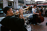 Musicians play outside of the Harvard Square subway station in Cambridge, Mass.