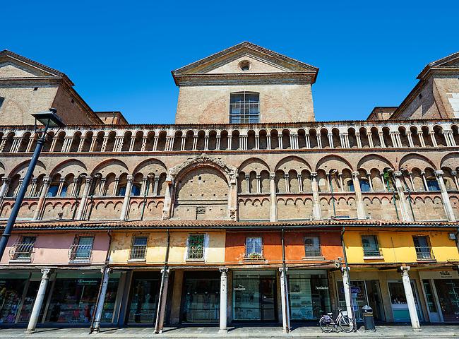 Medieval shops along the wall of the 12th century Romanesque Ferrara Duomo, Italy