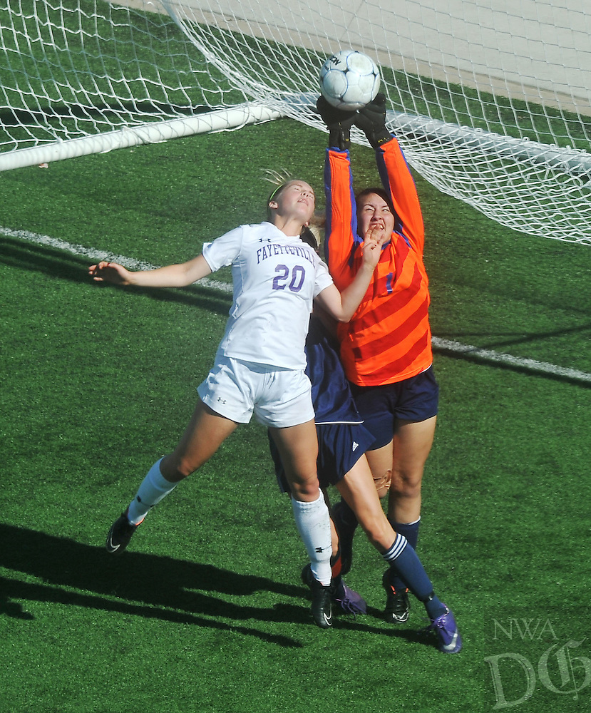 NWA Democrat-Gazette/MICHAEL WOODS &bull; @NWAMICHAELW<br /> Myra Tubb (20) from Fayetteville tries to make a shot on goal as Heritage goalie Micayla Fought makes the save Friday May 13, 2016 during the 7A State Soccer Tournament at Har-Ber High School in Springdale.