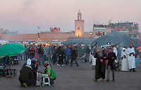 Evening view of crowds and stalls at Djemma el Fna square and marketplace, Medina, Marrakech, Morocco. Picture by Manuel Cohen