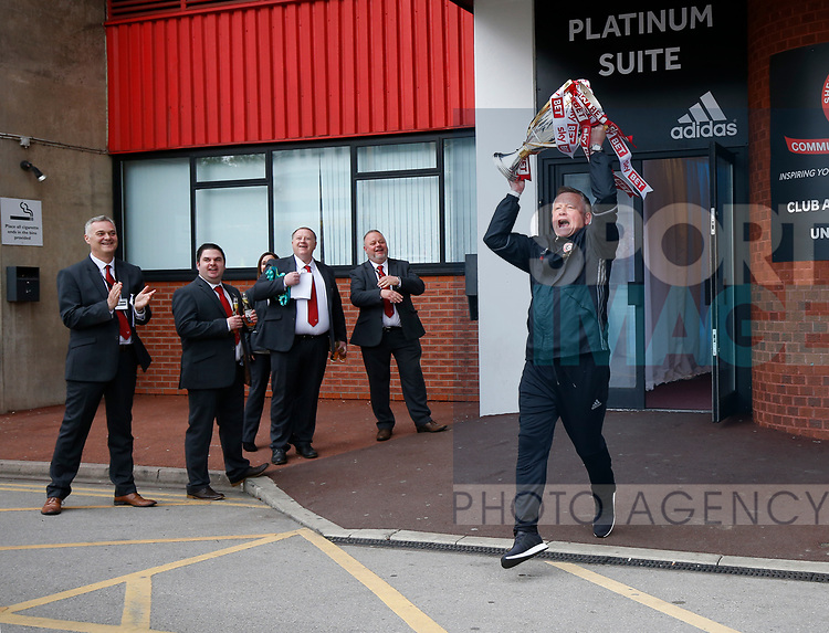 Chris Wilder manager of Sheffield Utd runs out with the trophy before boarding the bus the open top bus parade from Bramall Lane Stadium to Sheffield Town Hall, Sheffield. Picture date: May 2nd 2017. Pic credit should read: Simon Bellis/Sportimage