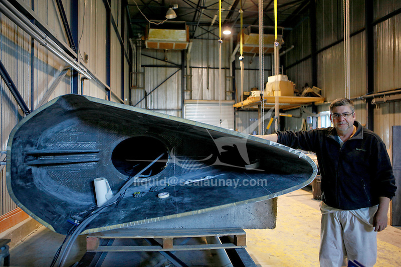 At the BSM, Lorient where the Ultime Class 100' VPLP designed trimaran Sodebo is refit.
