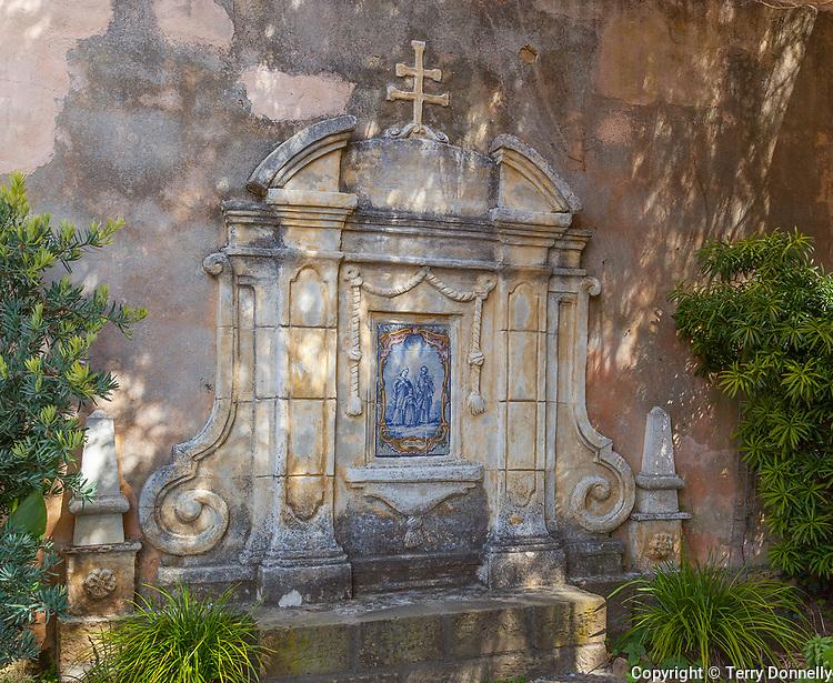 Monterey County, CA<br /> Prayer garden with tiled wall in courtyard of the Carmel Mission Basilica (1797) - Mission San Carlos Borromeo del Rio Carmelo
