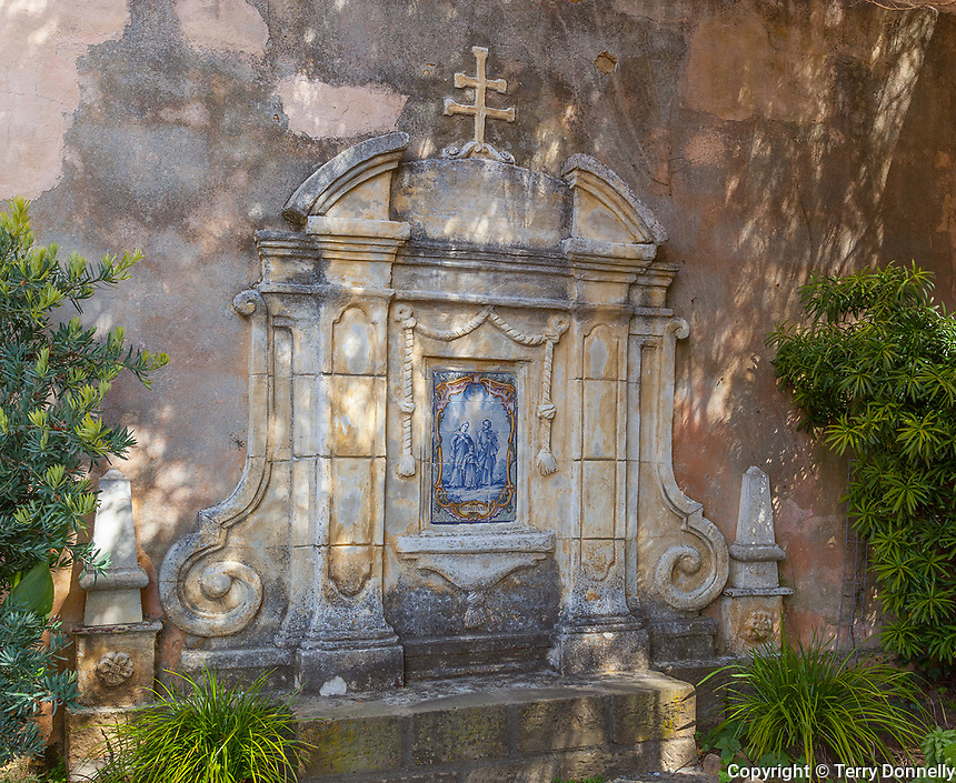 Monterey County, CA<br /> Prayer garden with tiled wall in courtyard of the Carmel Mission Basilica (1797) - Mission San Carlos Borromeo del Rio Carmelo