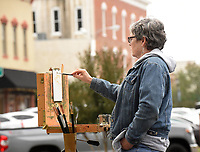 NWA Democrat-Gazette/FLIP PUTTHOFF <br />ARTIST'S EYE<br />Julie Hays, with Plein Air Painters of the Ozarks, paints Wednesday Oct. 10 2018 pictures of buildings in downtown Rogers along South First Street. The group of artists meets and paints at various locations in the region each Wednesday.