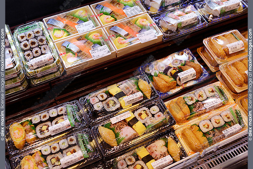 Packaged sushi rolls, prepared food on display in a Japanese supermarket. Tokyo, Japan.