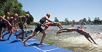 02 JUN 2013 - MADRID, ESP - Competitors dive off the pontoon for the start of the second swim lap during the men's ITU 2013 World Triathlon Series round in Casa de Campo, Madrid, Spain <br /> (PHOTO (C) 2013 NIGEL FARROW)
