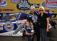 Apr. 3, 2011; Las Vegas, NV, USA: NHRA funny car driver Robert Hight (center) celebrates with wife Adria Hight and daughter Autumn Hight after winning the Summitracing.com Nationals at The Strip in Las Vegas. Mandatory Credit: Mark J. Rebilas-