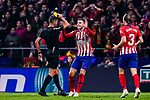 Lucas Hernandez of Atletico de Madrid (L) gets a yellow card from FIFA Referee Jesus Gil Manzano (L) during the La Liga 2018-19 match between Atletico Madrid and FC Barcelona at Wanda Metropolitano on November 24 2018 in Madrid, Spain. Photo by Diego Souto / Power Sport Images