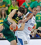 "France`s Boris Diaw (R) fights for the ball with Linas Kleiza (L) of Lithuania during European basketball championship ""Eurobasket 2013""  final basketball game between France and Lithuania in Stozice Arena in Ljubljana, Slovenia, on September 22. 2013. (credit: Pedja Milosavljevic  / thepedja@gmail.com / +381641260959)"