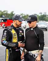 Aug 20, 2017; Brainerd, MN, USA; NHRA top fuel driver Tony Schumacher (left) with funny car driver Jonnie Lindberg during the Lucas Oil Nationals at Brainerd International Raceway. Mandatory Credit: Mark J. Rebilas-USA TODAY Sports
